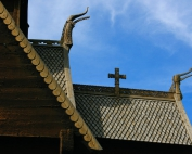 Decorative tiles and woodwork on church roof, Norway